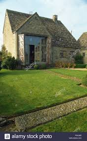 100 Barn Conversions For Sale In Gloucestershire Exterior Of Country Barn Conversion With Lawn Edged By Stone Path