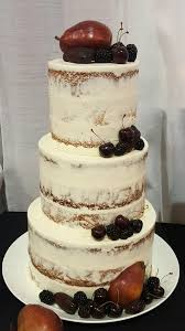 Semi Naked Cake Topped With Fresh Cherries Blackberries Red Pears And Dried Dates