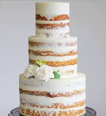 Another Example Of A Semi Naked Wedding Cake This Time With Very Minimal Flower Detail Between Tiers And Two Displayed On Glass Stand