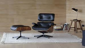 Vitra Vitra Lounge Chair & Ottoman   Walnut, Black Pigmented 12 Things You Didnt Know About The Eames Lounge Chair Why Are The Chairs So Darn Expensive Classic Chair Ottoman White With Black Base Our Public Bar Hifi Wigwam Vitra Walnut Black Pigmented Lounge Chair Armchairs From Architonic Version Pigmentation Nero 84 Cm Original Height 1956 Alinium Polished Sides Conran Shop X Departures Magazine