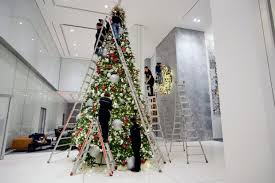 18 2017 Photo Employees Of The American Christmas Company Set Up Decorations In Lobby 1221 Avenue Americas Midtown