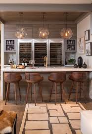I Love This Bar And Wine Storage Set Up Three Arteriors Beck Pendants Illuminating A Marble Waterfall Fitted With Wet Sink Gold Gooseneck