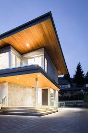 100 Butterfly Roof A And Dramatic Lighting Give This Home A Striking