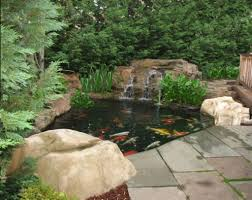 Small Backyard Koi Pond With Waterfall - Tips To Caring The Koi ... 67 Cool Backyard Pond Design Ideas Digs Outdoor With Small House And Planning Ergonomic Waterfall Home Garden Landscaping Around A Pond Flow Back To The Ponds And Waterfalls Call For Free Estimate Of Our Back Yard Koi Designs Febbceede Amys Office Large Backyard Ponds Natural Large Wood Dresser No Experience Necessary 9 Steps Tips To Caring The Idea Pinterest Garden Design