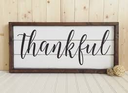 Thankful This Rustic Framed Wood Sign Features The Word In A Beautiful Script Font