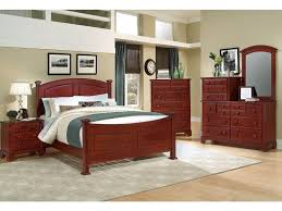 furniture cozy laminate wood flooring with dark wood tufted bed