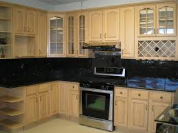 light brown wooden kitchen cabinet with glass door feat black