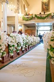 Church Wedding Ceremony With Aisle Runner Dark Green Carpet And Greenery On Pews