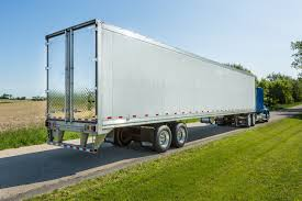 100 Stoughton Trucking PureBlue Side View Truck News
