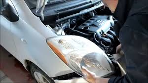 change a headlight turn signal or parking light on the toyota