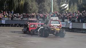 100 Monster Trucks Video Two Monster Trucks Pushing Squeezing Junk Cars At Sporting Event