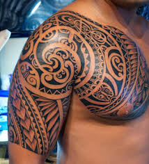 Swirly Polynesian Chest And Half Sleeve Tattoo 393x433
