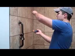 on the jobsite installing shower grab bars