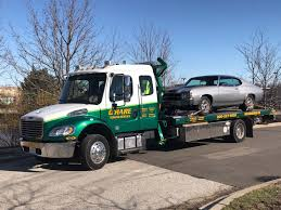 Towing And Recovery Service | O'Hare Towing Service Wtrucksfortotscom Worldwide Equipment Sales Llc Neowtrucks Gmc For Sale At American Truck Buyer Historical Society Classy Chassis Trucks Hauler Cversions Wrecker Tow N Trailer Magazine Jordan Used Inc Apple Towing Co Chicago Illinois A Police Car On A Tow Truck Stock Photo Vehicles For In Bridgeview Il Lynch 2006 Freightliner Business Class M2 Roll Back Item G Lift And Hidden Wheel System Repo