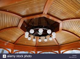 100 Wooden Ceiling Round Large Chandelier With Round Lamps On A Wooden Ceiling