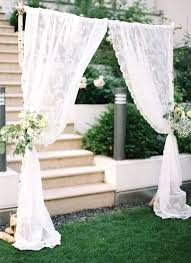 Arch Wedding Decorations Lace Table Runner Over A Rustic Wooden For