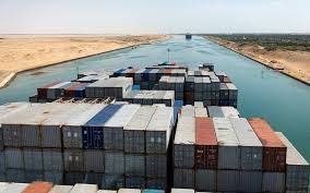 Shipping Containers Stand Aboard A Ship It Passes Through The Suez Canal