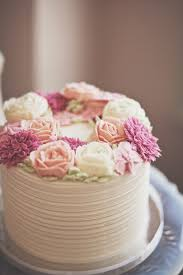 Rustic Buttercream Cake With Soft Pink And Cream Rose Flowers