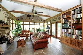 Rustic Living Room With Ceiling Fan French Doors Stone Fireplace Tiffany Style