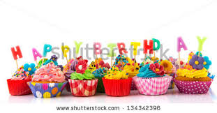 Colorful happy birthday cupcakes with candles isolated over white background