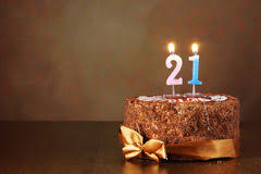 Birthday chocolate cake with burning candles as number twenty one Royalty Free Stock Image