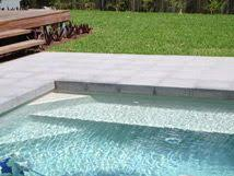 mirabella light limestone paving and pool coping in antiqued