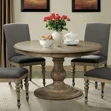 Corinne Wood Round Pedestal Dining Table in Sun Drenched Acacia