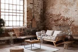 sessel und beige sofa im industriellen wohnzimmer interieur mit foto bialasiewicz auf envato elements