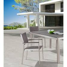 modern aluminum grey outdoor dining set with woven arm chairs