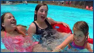 Girls Swim In The Swimming Pool