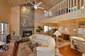 modern living room with hardwood floors balcony in waynesville