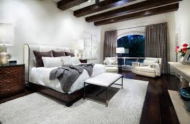 Inspiration For A Contemporary Dark Wood Floor And Brown Bedroom Remodel In Houston With White