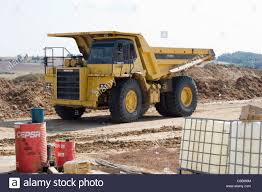 Dump Truck At Work Site Stock Photo: 34677908 - Alamy Bigdaddy Dump Truck Lorry With Tipper Cstruction Work Vehicle Car Yellow For Stock Photo Picture Zone In Progress Gifts Grey Building Kennecotts Monster Dump Trucks One Piece At A Time Kslcom Ford Trucks New Jersey Sale Used On Buyllsearch Excavator Loading Sand Into A The Quarry Tri Axle Auto Info Services Loren Pratt Trucking Large Image Free Trial Bigstock Update Driver Seriously Injured In Crash With Truck Dalton Of Moorings Parking Boats