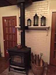 Painted The Brick Behind Wood Stove White