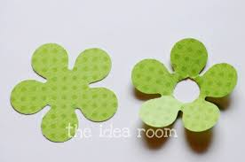 First I Cut Out Some Scrapbook Paper 2 Flowers In Each Color Flower Has A Front And Back To Hide The Stick
