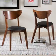 baxton studio sumner black faux leather upholstered dining chairs