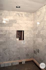grey pattern marble shower with built in niche