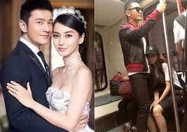 Huang Xiaoming And Angelababy Were Invited To A Fashion Show In Paris Recently Yesterday The Couple Was Seen At Airport Likely Depart