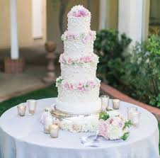 Frilly White Wedding Cake With Fresh Pink Flowers