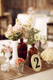 Country Rustic Chic Wedding Table Centerpiececlusters Of Mismatched Bottles
