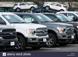 A Row Of New Ford F-series Pick-up Trucks And Explorer SUV's At A ... Americas Best Selling Truck For 40 Years Ford Fseries Built Recalls Nearly 3500 Trucks That May Roll Away When Pre Owned F Series Seattle Washington Fire Risk Forces Recall Of Pickup Trucks In Canada And Transport Issues Notice Super Duty 2018 Limited First Impressions Youtube Tells Sedans To Shove It As Break Sales Records Recalling 11million Door Latch Problem Isuzu 11 Ton Truck Ireland Used Ninth Generation Wikiwand Pickup Artist How The Took Over America 1a