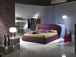 white ceramic flooring tile with purple bedstead green bedlinen