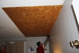 Inexpensive Basement Ceiling Ideas by Remodelaholic Rustic Pallet Wood Ceiling Tutorial