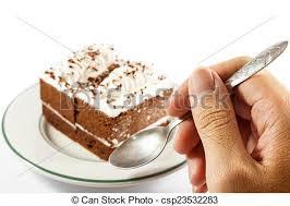 der mensch isst kuchen die person hält löffel und