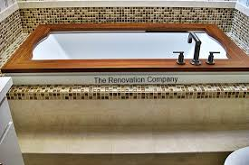 Tiling A Bathtub Deck by Bathrooms The Renovation Company