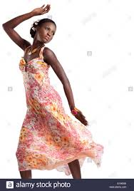 beautiful young black woman dancing in a pink floral summer dress