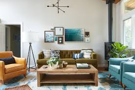 green tufted sofa with industrial pendant light living room