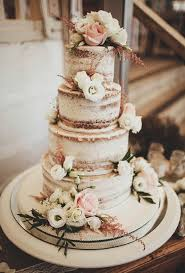 Brides Nearly Naked Wedding Cake With Foliage A Rustic