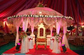 Indian Outdoor Wedding Lights Decorations With Small Canopy And White Covered Chairs Also Long Fabric