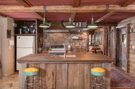 Rustic Kitchen Wall Decor Stainless Steel Exhaust Over Island White Tile Backsplash Tan Granite Countertop